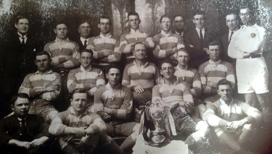 The Cootamundra team of 26 Sep 1923 which won the Maher Cup outright. In 1924 they put the money sinner back into play. BacK: Left-Right; M.J. Ryan (Selector), M. Tuncheon, P. J. Kiley (Hon Sec), Bill Lesberg, Bob Condon, C. Swartzel, D.J. Rand (President), B. Kinnane, W. Farrer (vice President), Delaney, Referee (Sydney) 2nd Row: F. Hayward, Jim Watson, Phil Regan (Captain & Coach), Ray Sheedy, L.T. Quinlan Front Row: C.H. Inson (Hon Treasurer), Brian O'Connor, Curtis 'Dick' Pellow, Eric Weissel, Tom 'Dipper' McDevitt Absent players: Wal Franklin, Phil Freestone, T. Ryan, J. Large, J. Kelley, P. Mills, Charlie Schofield. (These would have been players who didn't play in the particular match but contributed in other games)
