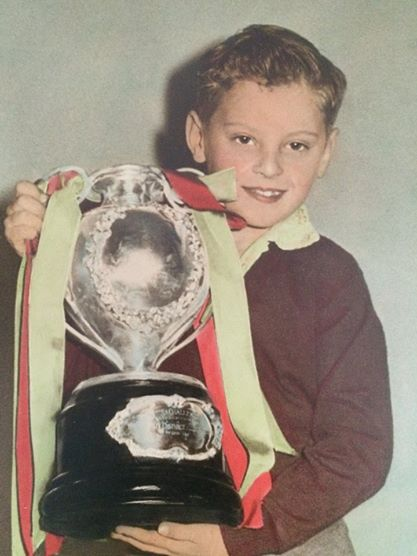 Young Jimmy Dowell holds the Maher Cup. Photography by Ted Shai-Hee posted on Lost Tumut Facebook site. Probably 1957. Note that Tumut played in Red & Green instead of the Sky Blue.